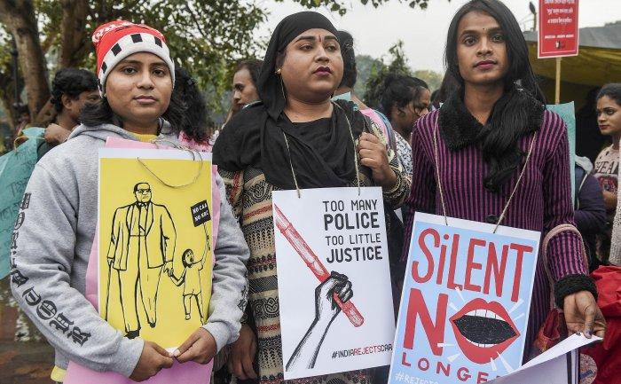 Protestors from transgenders, women and queer communities take part in a protest rally against the amended Citizenship Act, NRC and NPR, in Kolkata. (PTI Photo)