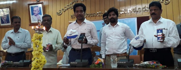 Deputy Commissioner Dr Bagadi Gautham displays a mobile app used for the economic census in Chikkamagaluru.