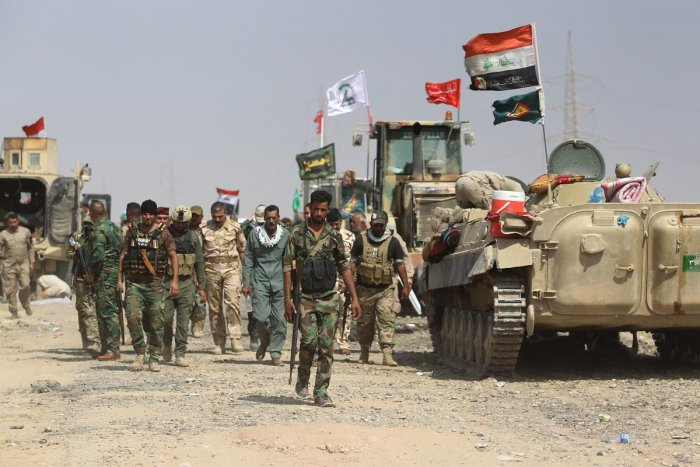 """""""It's not a halt,"""" the source said, adding: """"We have increased security and defensive measures at Iraqi bases that host coalition troops."""""""