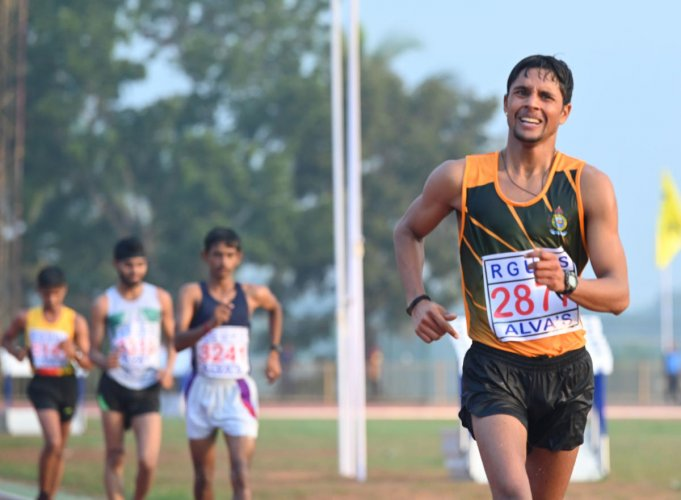 Juned K T of Mangalore University in action during the 20-km race walk for men at the 80th Inter University Athletic Meet in Moodbidri.