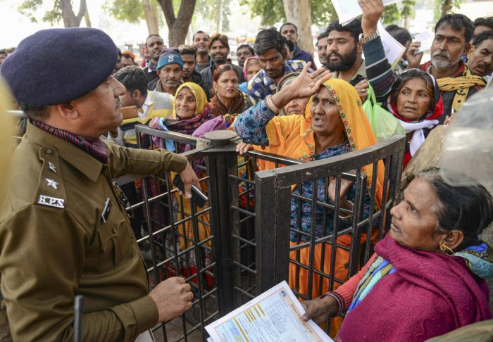 People protest at the JK Lon hospital, where at least 100 infants have died in the month of December (Photo Credit: PTI)