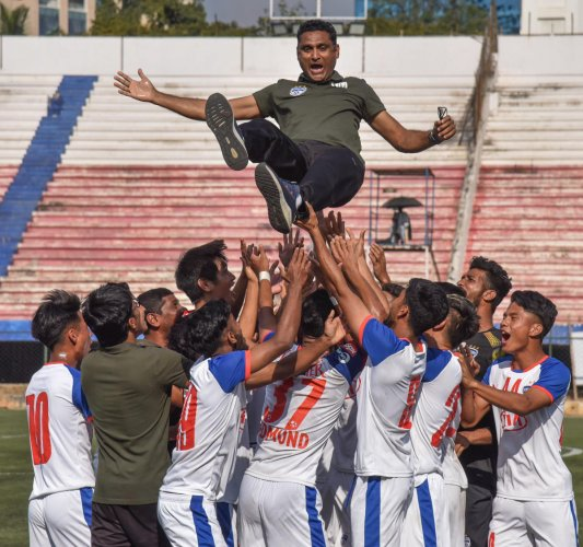 Bengaluru FC players celebrate their second straight BDFA Super Division League triumph by lifting coach Naushad Moosa in the air on Saturday. DH PHOTO/ SK Dinesh