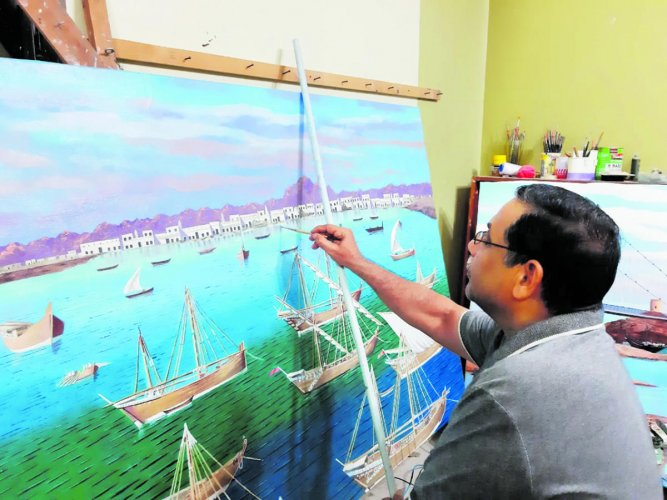Mohamad Nazir gives the final touches to an artwork.