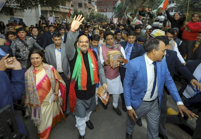 Union Home Minister Amit Shah during door -to- door campaign on CAA at Lajpat Nagar in New Delhi, Sunday, Jan. 5, 2020. Photo/PTI