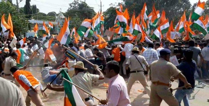 Police cane BJP workers and members of Bharatiya Hitharakshana Vedike during a pro-CAA rally in Kolar on Saturday. DH photo