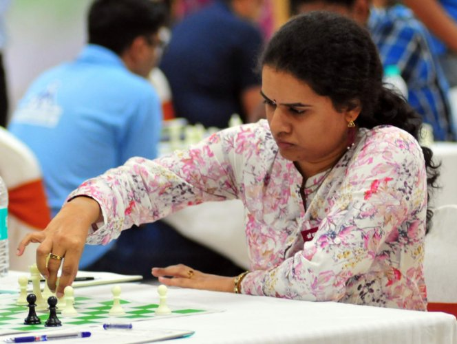 Koneru Humpy plays against Lalith Babu M R during All India Public Sector Chess Tournament, at Hotel Sandesh The Prince in Mysuru. (DH Photo)