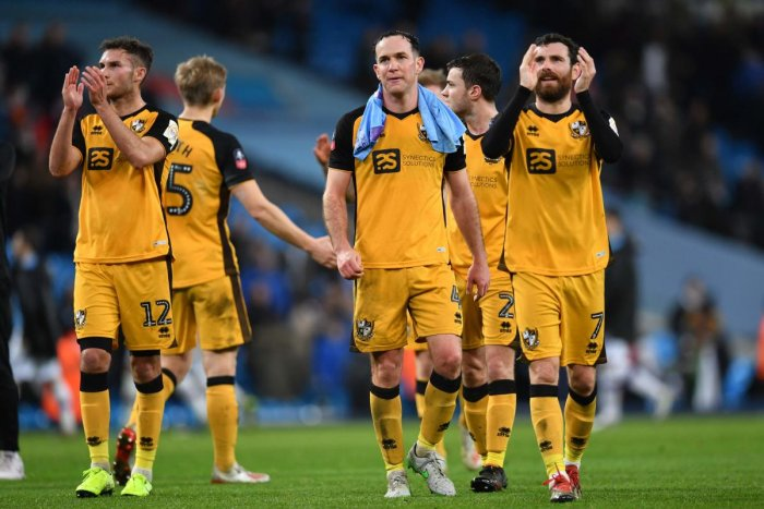 Port Vale's players applaud supporters on the pitch after the English FA Cup third round football match between Manchester City and Port Vale at the Etihad Stadium in Manchester, north west England, on January 4, 2020. (AFP Photo)