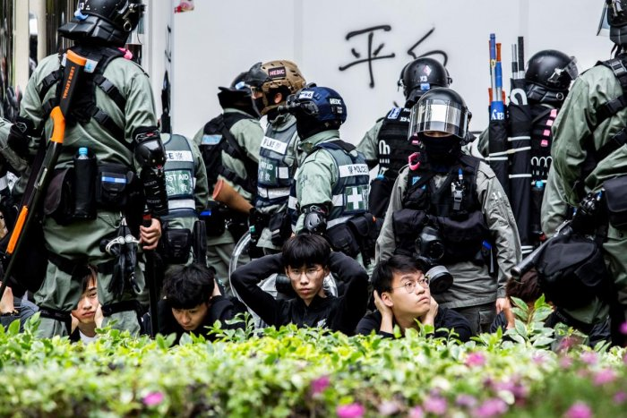 People are detained by police during a clearance operation after a demonstration against parallel trading in Sheung Shui in Hong Kong on January 5, 2020.  (Photo by ISAAC LAWRENCE / AFP)