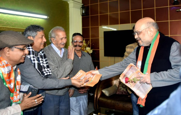 New Delhi: Union Home Minister Amit Shah during door -to- door campaign on CAA at Lajpat Nagar in New Delhi, Sunday, Jan. 5, 2020. (PTI Photo)