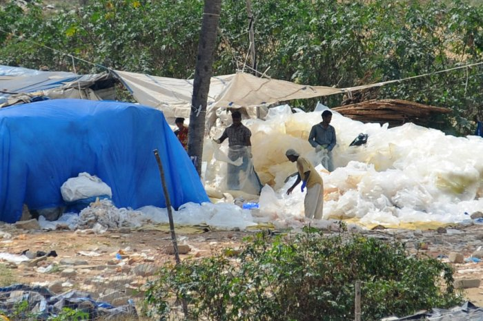 Residents living along the Vrishabhavati stream complain about illegal plastic segregation units that have been setting fire to plastic waste and leaving the area under thick carpet of smog. A few have even alleged that the units have encroached on the river course of Vrishabhavati. | DH Photo: Pushkar V