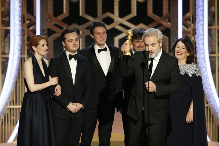 """This image released by NBC shows filmmaker Sam Mendes accepting the award for best motion picture drama for """"1917"""" at the 77th Annual Golden Globe Awards at the Beverly Hilton Hotel in Beverly Hills, Calif. (AP Photo)"""