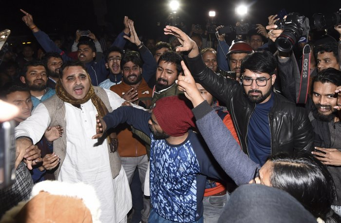 Students and other people shouting slogans at out side of the JNU campus. (PTI Photo)