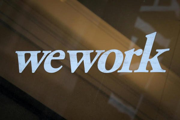 The WeWork logo is displayed on the entrance of a co-working space in New York City, New York U.S., January 8, 2019. (Reuters photo)