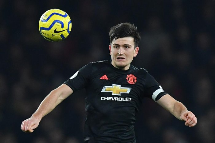 Manchester United's English defender Harry Maguire keeps his eyes on the ball during the English Premier League football match between Arsenal and Manchester United at the Emirates Stadium in London on January 1, 2020. (AFP Photo)