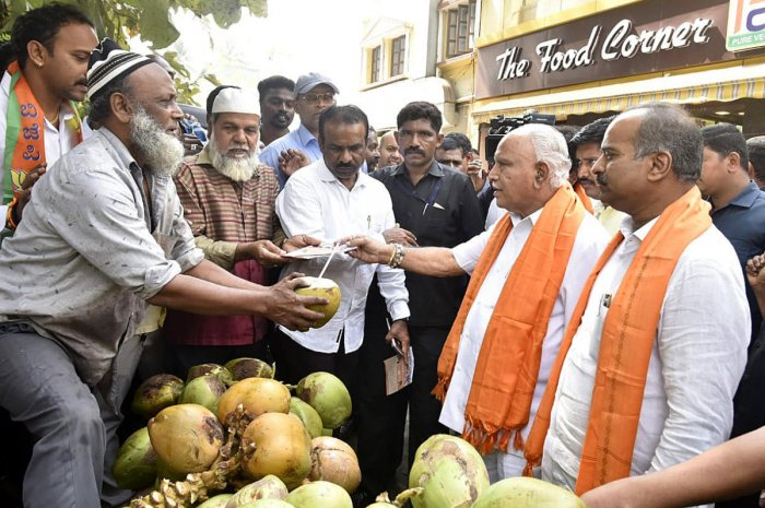 Chief Minister B S Yediyurappa, MP P C Mohan along with other BJP leaders and supporters seen during a CAA awareness campaign in Bengaluru on Sunday. DH Photo