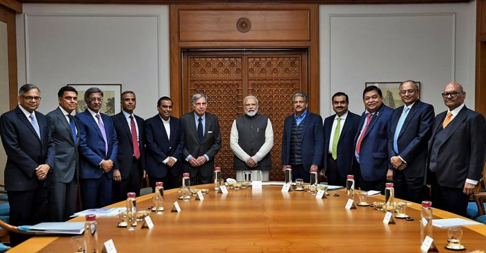 Prime Minister Narendra Modi poses for a group photo with Reliance Industries chairman Mukesh Ambani, Tata Group patriarch Ratan Tata, Business tycoon Anand Mahindra and others during an interaction with leading business stalwarts to discuss ways to improve growth and job creation, in New Delhi. PTI