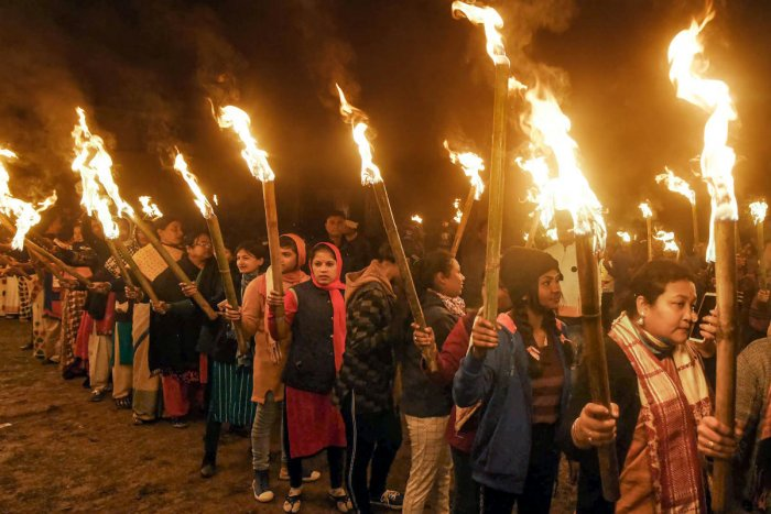 Activists of All Assam Students Union take part in a torch rally against the amended Citizenship Act. (Credit: PTI)