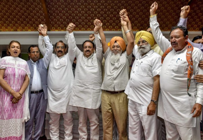 Fatehgarh Sahib MP Harinder Singh Khalsa, who recently joined BJP leaving the AAP, with other BJP leaders and workers during his Lalkar rally, in Amritsar, Sunday, April 7, 2019. (PTI Photo)