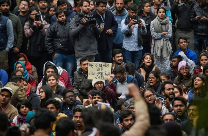 Students stage a protest at main Gate of JNU over Sunday's violence, in New Delhi, Monday, Jan. 6, 2020. Violence broke out at Jawaharlal Nehru University on Sunday night as masked men armed with sticks attacked students and teachers and damaged property on the campus, prompting the administration to call in police.