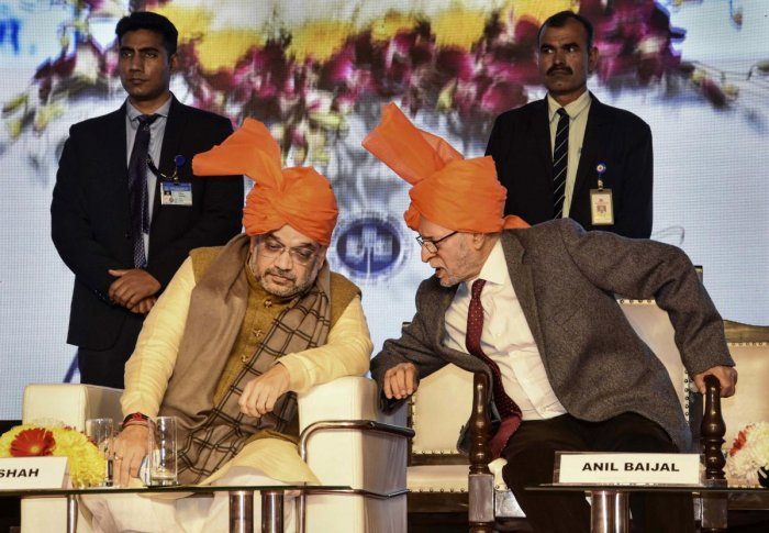 Union Home Minister Amit Shah talks with Delhi Lt. Governor Anil Baijal during inauguration of a 'Cycle Walk', in New Delhi,