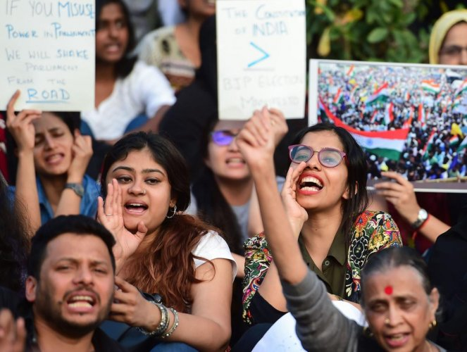Protestors display placards and raise slogans during a protest against the Citizenship Amendment Act (CAA), National Register of Citizenship (NRC) and National Population Register(NPR) in Bengaluru. PTI