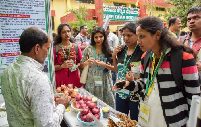 People throng a stall displaying farm products at the 107th Indian Science Congress in Bengaluru on Monday. DH PHOTO
