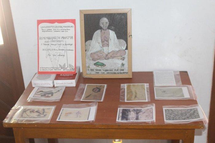 Art work on Mahatma Gandhi displayed to pay tribute to Mahatma Gandhi through music and paintings organised by English Association of University College, Mangaluru.