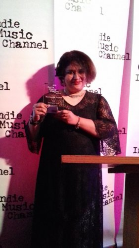 Neecia Majolly with the 'Best Alternative Song' award at the Indie Music Channel Awards, Hollywood.