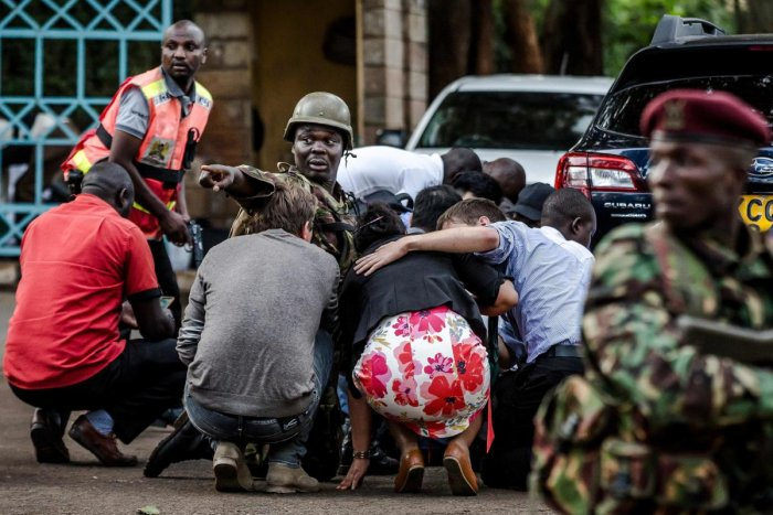 In this file photo taken on January 15, 2019 Special forces protect people at the scene of an explosion at a hotel complex in Nairobi's Westlands suburb. (AFP Photo)