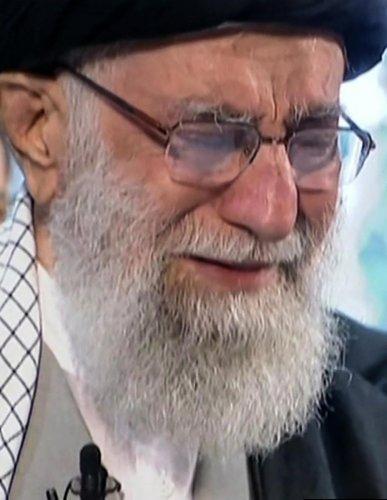 Iranian Supreme Leader Ayatollah Ali Khamenei weeping as he recites a prayer in front of the coffin of slain Iranian military commander Qasem Soleimani. (AFP photo)