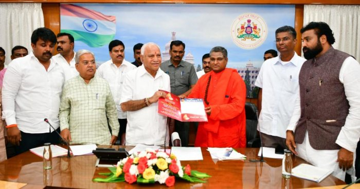 A delegation of Valmiki community, led by Prasannananda Swami, submits a memorandum to Chief Minister B S Yediyurappa in Bengaluru on Monday. DCM Govind Karjol, Health Minister B Sriramulu, MLAs Raju Gouda and Satish Jarkiholi are seen. DH PHOTO
