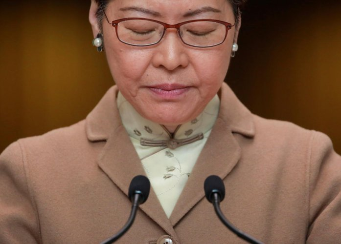 Hong Kong Chief Executive Carrie Lam looks down as she attends a news conference in Hong Kong. (REUTERS photo)