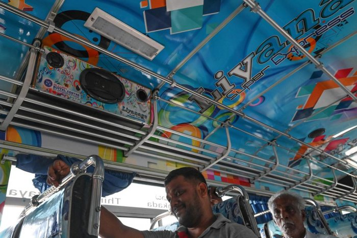 Passengers sit under a speaker in a private bus in Piliyandala, a suburb of Colombo on January 2, 2020. - Sri Lanka's government on January 2 gave bus operators two weeks to turn down the notoriously loud music in their vehicles following complaints from passengers. AFP
