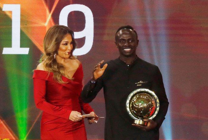 Senegal's Sadio Mane receives the men's player of the year award. (Reuters Photo)