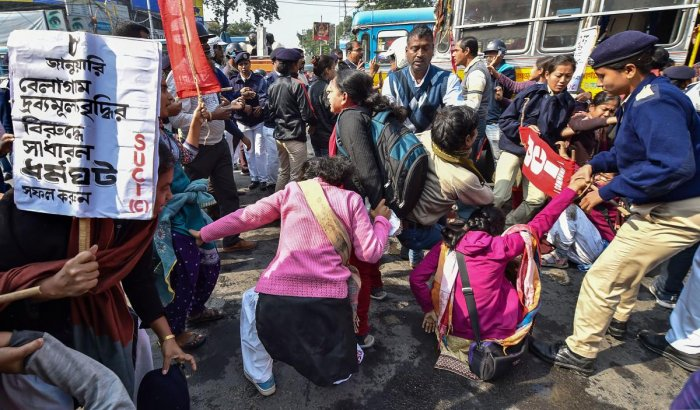 Police detain SUCI activists who were staging a road blockade in support of the trade unions' Bharat Bandh, in Kolkata. (PTI photo)