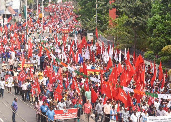 Trade union workers take out a march during their nationwide 24-hour general strike, in Thiruvananthapuram. (PTI photo)