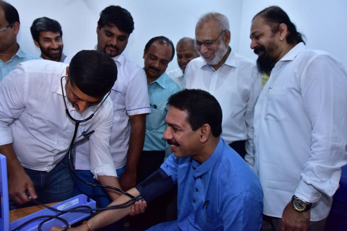 Dakshina Kannada MP Nalin Kumar Kateel gets his blood pressure checked during the inauguration of the free emergency medical service centre set up by Unity Hospital at Mangaluru Central Railway station on Sunday.