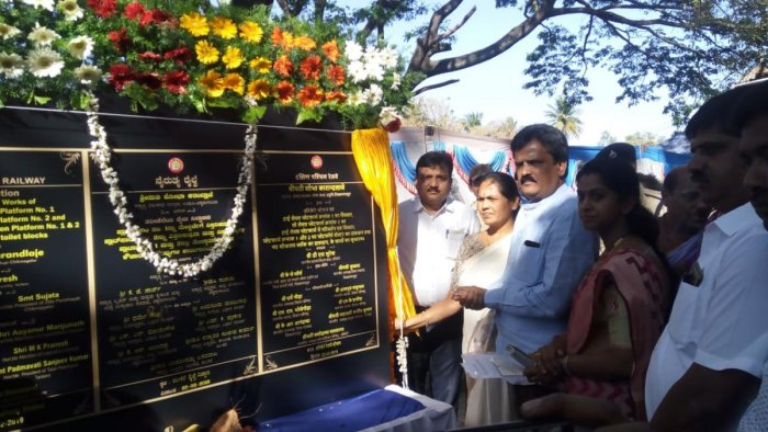 MP Shobha Karandlaje unveils a plaque after laying the foundation for development works at Tarikere Railway Station.