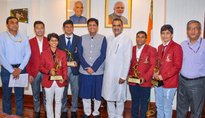 Union Railway Minister Piyush Goyal in a group photo with the National Award-winning Railway sportspersons, in New Delhi. (PIB/PTI Photo)