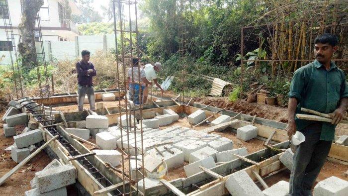 The work on Coorg Village in progress near Raja Seat in Madikeri. DH Photo