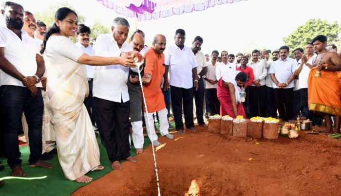 Housing Minister V Somanna lays the foundation stone for the construction of 460 houses on 8.22 acres of land at Herga in Saralebettu ward in Udupi on Wednesday.