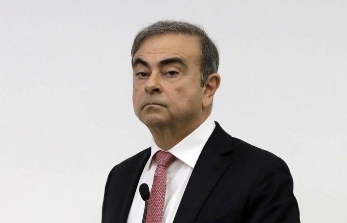 TOPSHOT - Former Renault-Nissan boss Carlos Ghosn looks on before addressing a large crowd of journalists on his reasons for dodging trial in Japan, where he is accused of financial misconduct, at the Lebanese Press Syndicate in Beirut on January 8, 2020.