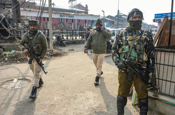 Security personnel near the site of a grenade attack at Kawdara in Downtown Srinagar, Saturday, Jan. 4, 2020. (PTI Photo/S. Irfan)