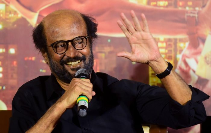 Thousands of die-hards would keep a vigil outside theatres across Tamil Nadu to catch their Thalaivar on screen at the break of the dawn. (AFP photo)