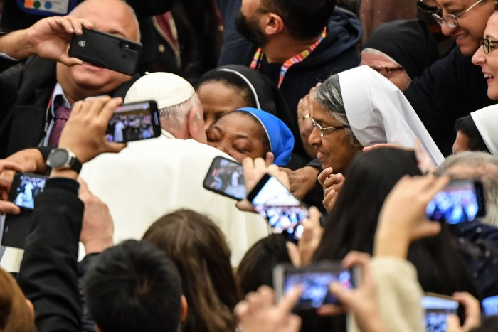 "Pope Francis kisses a nun who had been shouting ""Long live the pope!"" as he arrives for the weekly general audience on January 8, 2020 at Paul-VI hall in the Vatican. (AFP Photo)"