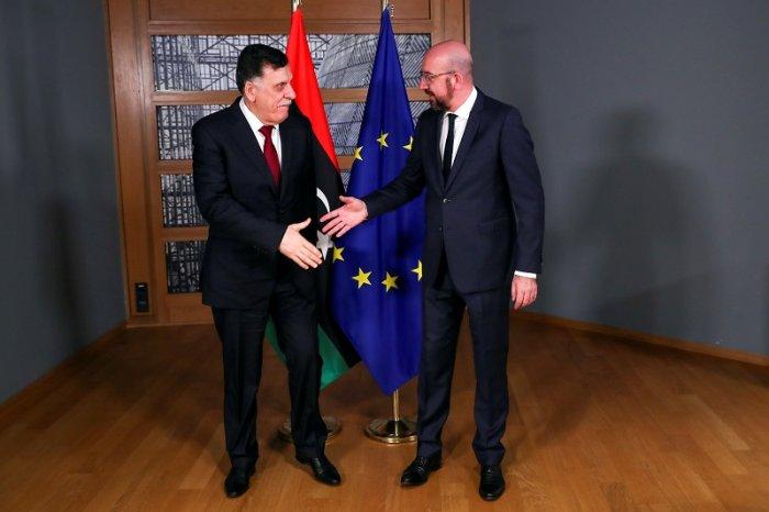 Libya's UN-recognised Prime Minister Fayez al-Sarraj meets European Council President Charles Michel in Brussels, Belgium . (Reuters Photo)