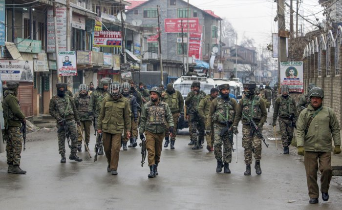 ecurity personnel patrol a street after clashes which erupted after a police vehicle collided with a car in an accident killing a 10th class student Tehseen Ahmed Bhat, at Nowgam in Srinagar. (PTI Photo)