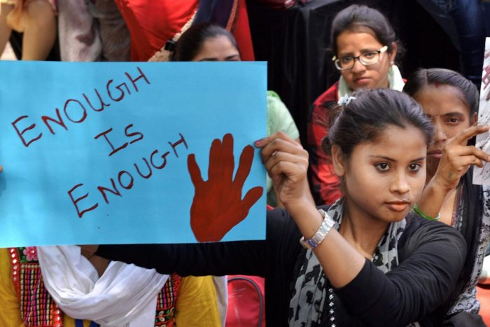 Women and children during a dharna against rape incidents at Rajghat in New Delhi.(PTI Photo)