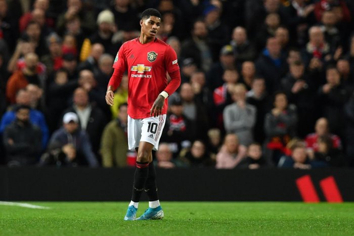 Manchester United's English striker Marcus Rashford reacts during the English League Cup semi-final first leg football match between Manchester United and Manchester City at Old Trafford in Manchester. (AFP Photo)