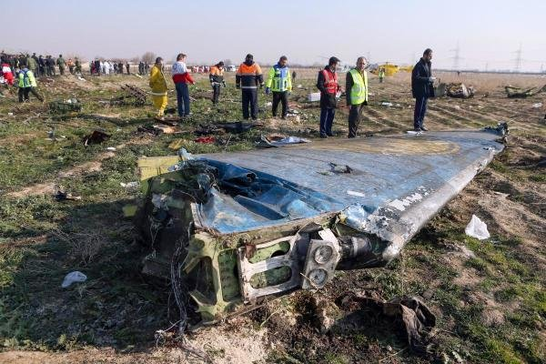 A handout photo provided by the Iranian news agency IRNA on January 8, 2020, shows rescue teams working at the scene of a Ukrainian airliner that crashed shortly after take-off near Imam Khomeini airport in the Iranian capital Tehran. (AFP Photo)